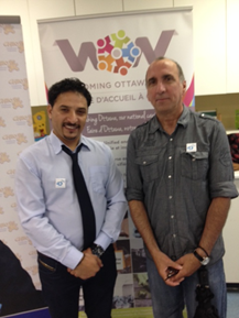 Mohammed Ali and Charles St-Louis at cheque presentation ceremony at CHEO during Welcoming Ottawa Week