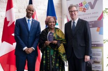 Shukria receives her Welcoming Ambassador award from Minister Ahmed Hussen, IRCC and Mayor Jim Watson